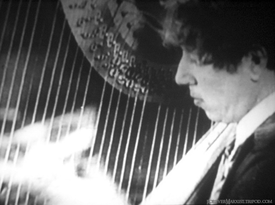 playing When My Dreams Come True on the harp